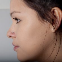 Nostril piercing by Matt Bressmer