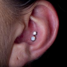 Double conch piercing by Matt Bressmer