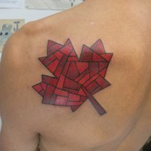 Tattoo by James Jameserson, red maple leaf