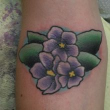 Tattoo by James Jameserson, african pansy
