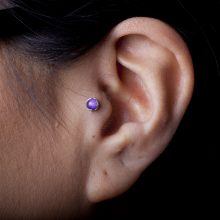 Tragus piercing by Matt Bressmer