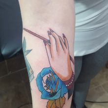 Hand and blue rose by Ren