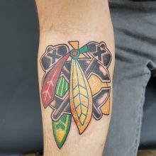 Sports team tattoo by Ren