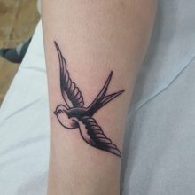 Swallow tattoo by Ren