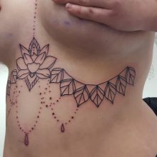 Underboob chandelier tattoo by Ren