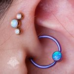 Forward helix and daith piercing by Matt
