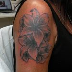 Tattoo by James Jameserson, lily flowers