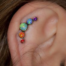 Helix piercing with a rainbow cluster from Anatometal