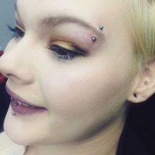eyebrow piercing by Tabatha Andreason