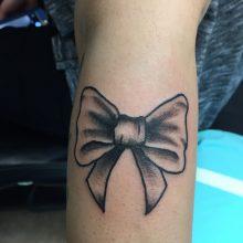 Teemu bow tattoo