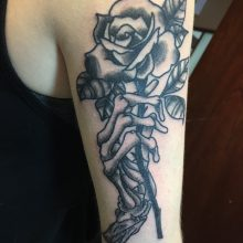 Teemu skeleton hand and rose tattoo