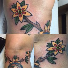 Teemu yellow flowers tattoo