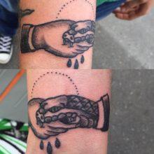 Teemu snake bite handshake tattoo
