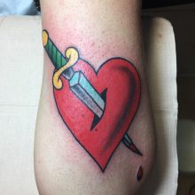 Teemu heart and dagger tattoo