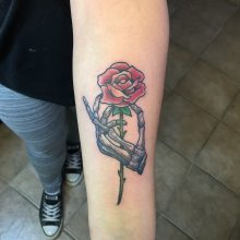 Teemu skeleton hand and rose