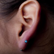 Transverse Lobe Piercing by Matt Bressmer